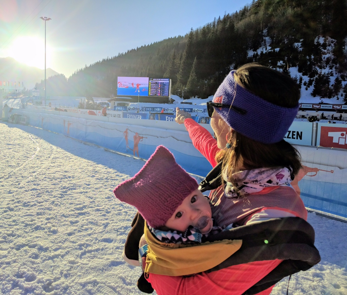 Erika points at the final score board while Ophelia waits for the podium!